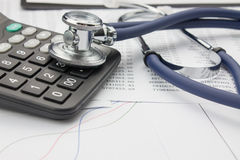 Stethoscope and calculator. Close up of stethoscope and calculator Royalty Free Stock Images