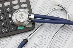 Stethoscope and calculator. Close up of stethoscope and calculator Royalty Free Stock Image