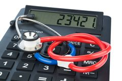 Stethoscope and calculator stock image