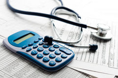 Stethoscope and calculator symbol for health Royalty Free Stock Photos
