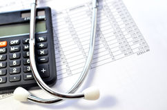 Stethoscope and calculator symbol for health care. Health care costs. Stethoscope and calculator symbol for health care costs or medical insurance Royalty Free Stock Image