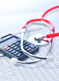 Stethoscope and calculator symbol for health care Royalty Free Stock Images