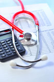 Stethoscope and calculator symbol for health care Stock Photos