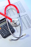 Stethoscope and calculator symbol for health care Royalty Free Stock Photography