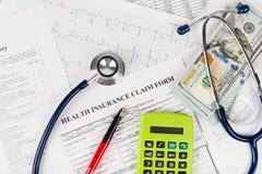 Stethoscope and calculator symbol Stock Photos