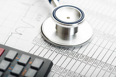 Stethoscope and calculator symbol for health care costs Royalty Free Stock Photos