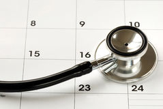 A stethoscope on the calendar Stock Image