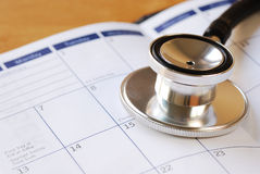 A stethoscope on the calendar Stock Photography