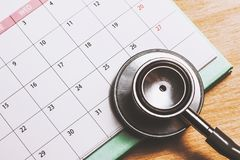 Stethoscope on the calendar. Doctor appointment Stock Image