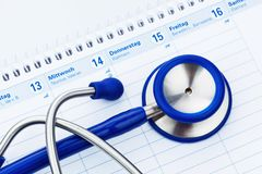 Stethoscope and calendar. Medical appointment Stock Photos