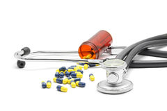 Stethoscope and Capsules Stock Photography