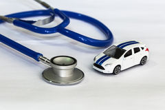 Stethoscope with car (Selective Focus) Diagnosis and repair of v Royalty Free Stock Photo