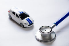 Stethoscope with car (Selective Focus) Diagnosis and repair of Stock Image
