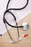 Stethoscope and cardiogram Stock Photo