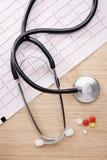 Stethoscope and cardiogram Stock Photo