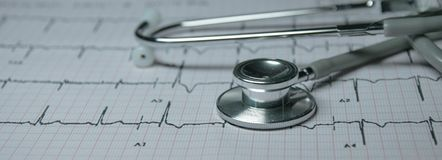 Stethoscope on cardiogram. A gray stethoscope on cardiogram stock image