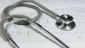 Stethoscope on the electrocardiogram. Stethoscope on the cardiogram.Health care concept stock photography