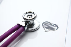 Stethoscope with cardiogram lying on desk in hospital Royalty Free Stock Photography