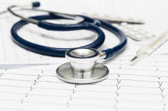 Stethoscope on the cardiogram Stock Photography