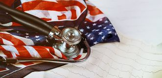 Stethoscope and cardiogram on table US flag. US flag and stethoscope on cardiogram on table, usa, american, health, medical, medicine, care, doctor, equipment stock photography