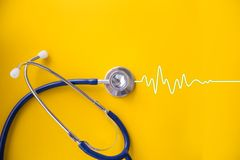 Stethoscope with cardiogram Stock Photography