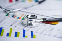 Stethoscope, Charts and Graphs spreadsheet paper, Finance, Account, Statistics, Investment, Analytic research data economy. Spreadsheet and Business company stock images
