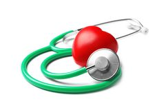 Stethoscope for checking pulse and red heart. On white background royalty free stock photography