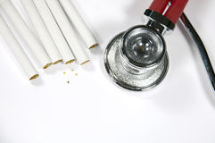 Stethoscope and cigarette Royalty Free Stock Images