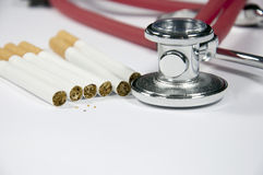Stethoscope and cigarette Royalty Free Stock Photography