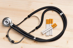 Stethoscope and cigarette Stock Photos