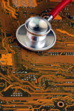 Stethoscope and circuit board Stock Photo