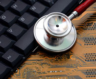 Stethoscope and circuit board Royalty Free Stock Photography