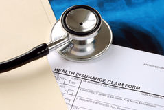 A stethoscope on the claim form Royalty Free Stock Image