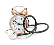 Stethoscope and clock Royalty Free Stock Photos
