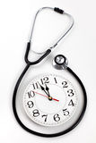 Stethoscope and Clock Royalty Free Stock Images