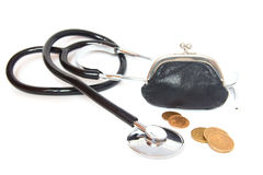Stethoscope, coins and wallet. Stethoscope, coins and vintage wallet isolated on white background. Medical budget,  healthcare value, economy concept Stock Images