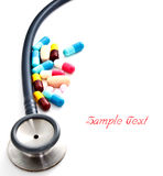 Stethoscope and colorful pills Stock Photos