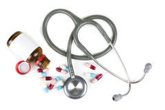 Stethoscope and colorful pills Royalty Free Stock Photo