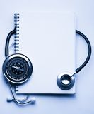 Stethoscope, compass and notebook Stock Image