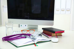 Stethoscope and computer on a desk in the office Stock Image