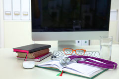 Stethoscope and computer on a desk in the office Royalty Free Stock Image