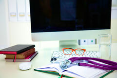 Stethoscope and computer on a desk in the office Royalty Free Stock Photography