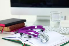 Stethoscope and computer on a desk in the office.  Royalty Free Stock Image