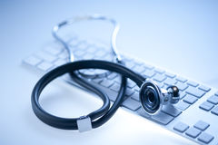Stethoscope on a computer keyboard Stock Image
