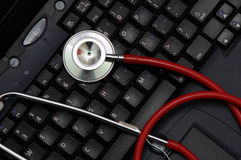 Stethoscope on a computer keyboard Royalty Free Stock Photo