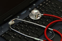 Stethoscope on a computer keyboard Stock Images