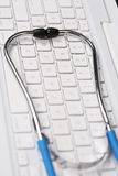 Stethoscope by  computer keyboard Stock Photography