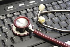 Stethoscope on a computer keyboard Royalty Free Stock Image