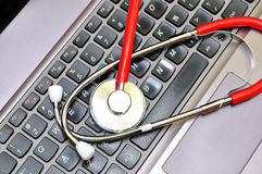Stethoscope on a computer keyboard royalty free stock photography