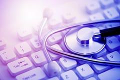 Stethoscope on computer keyboard royalty free stock image